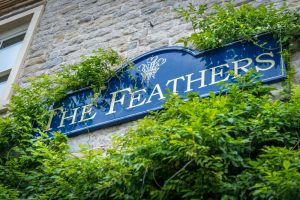 The Feathers signage